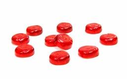 被隔绝的红色棒棒糖 免版税库存图片