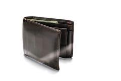 被隔绝的老棕色皮革钱包 库存照片