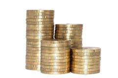 被隔绝的金黄硬币堆  免版税库存图片