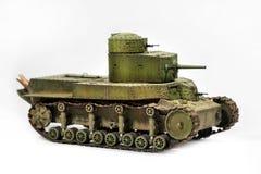 被隔绝的一辆老坦克的纸模型  图库摄影
