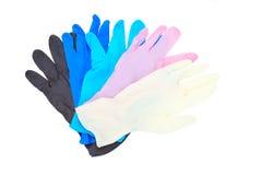 被隔绝的五颜六色的乳汁手套 免版税库存照片