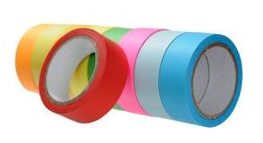 被隔绝的五颜六色的磁带卷 免版税库存照片