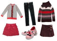 被隔绝的儿童女孩的现代秋天衣裳 库存图片