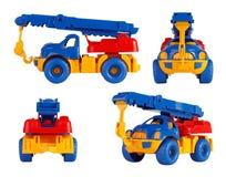 被隔绝的儿童玩具汽车起重机 不同的角度 免版税库存照片