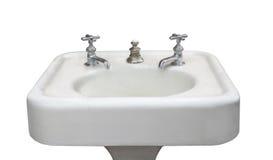 被隔绝的古色古香的白色水槽 免版税库存图片