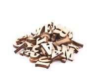 被隔绝的堆木头被雕刻的信件 图库摄影