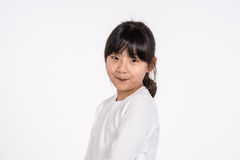 -被隔绝的少年亚洲女孩儿童演播室画象射击 免版税库存图片