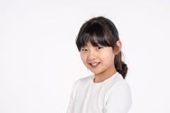-被隔绝的少年亚洲女孩儿童演播室画象射击 免版税图库摄影
