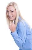 被隔绝的愉快的年轻白肤金发的女商人-蓝色女衬衫。 库存图片