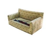 被隔绝的打破的沙发透视图 库存图片