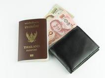 被隔绝的护照、金钱和黑钱包 免版税库存图片