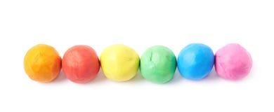 被隔绝的排队的彩色塑泥球 免版税图库摄影