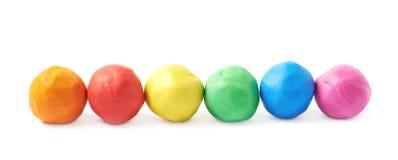 被隔绝的排队的彩色塑泥球 免版税库存照片