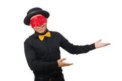 黑被隔绝的服装和红色面具的年轻人 免版税库存照片