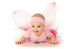 被隔绝的服装的美丽的矮小的婴孩 免版税库存照片