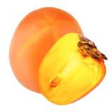 被隔绝的柿子 一个半在白色ba的柿子果子 库存照片