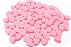 被隔绝的桃红色心脏糖果 库存照片