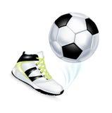 被隔绝的橄榄球和体育鞋子 免版税图库摄影