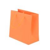 被隔绝的橙色纸购物袋 库存图片