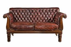 被隔绝的沙发棕色皮革古色古香减速火箭 库存图片