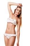 被隔绝的游泳衣的亭亭玉立的性感的妇女 免版税库存照片