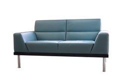 被隔绝的灰色皮革沙发 免版税库存照片