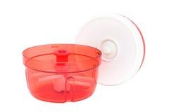 被隔绝的现代塑料厨房切菜机 免版税库存照片