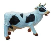 被隔绝的白色和黑母牛玩具小雕象 库存图片