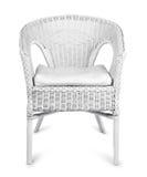 被隔绝的白色藤椅 免版税库存图片