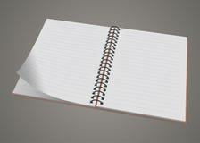 被隔绝的空白的现实螺旋笔记薄笔记本 免版税库存照片