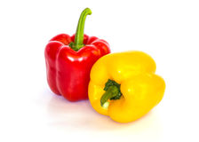 被隔绝的红色和黄色甜椒 免版税库存照片