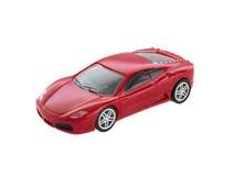 被隔绝的红色玩具跑车 免版税库存图片