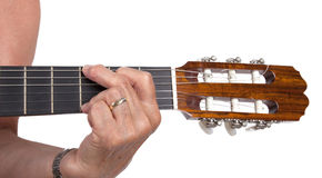 被隔绝的老手和吉他 免版税库存图片