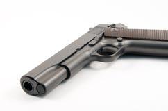 被隔绝的老1911年手枪 免版税图库摄影