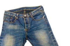 被隔绝的蓝色牛仔裤 免版税库存照片