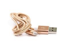 被隔绝的被折叠的USB闪电缆绳 免版税库存图片