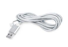 被隔绝的被折叠的USB闪电缆绳 库存照片