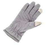被隔绝的触摸屏显示的冬天灰色手套 免版税库存照片