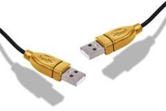 被隔绝的金黄USB缆绳 免版税库存照片