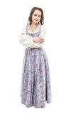 被隔绝的长的中世纪礼服的年轻美丽的妇女 免版税库存照片