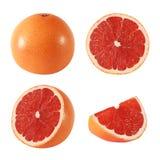 被隔绝的整个和被切的葡萄柚果子的汇集 免版税库存照片