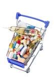 被隔绝的购物车充分与药片和胶囊的医学 免版税图库摄影