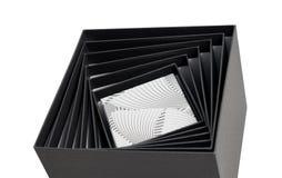 被隔绝的黑白色箱子开放螺旋礼物 库存图片