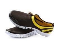 被隔绝的轻的连续体育鞋子 免版税库存照片