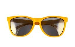 被隔绝的黄色太阳镜 免版税库存图片