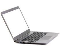 被隔绝的轻量级便携式计算机白色屏幕 免版税库存照片