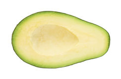 被隔绝的avacado果子的一半 免版税库存图片