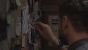 被集中的侦探标号犯罪事件在船上与红色串,链接 股票视频