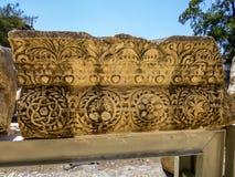 被雕刻的石块在古老Capernaum,以色列 库存照片