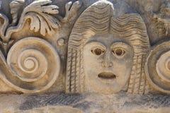 被雕刻的希腊面具 免版税图库摄影